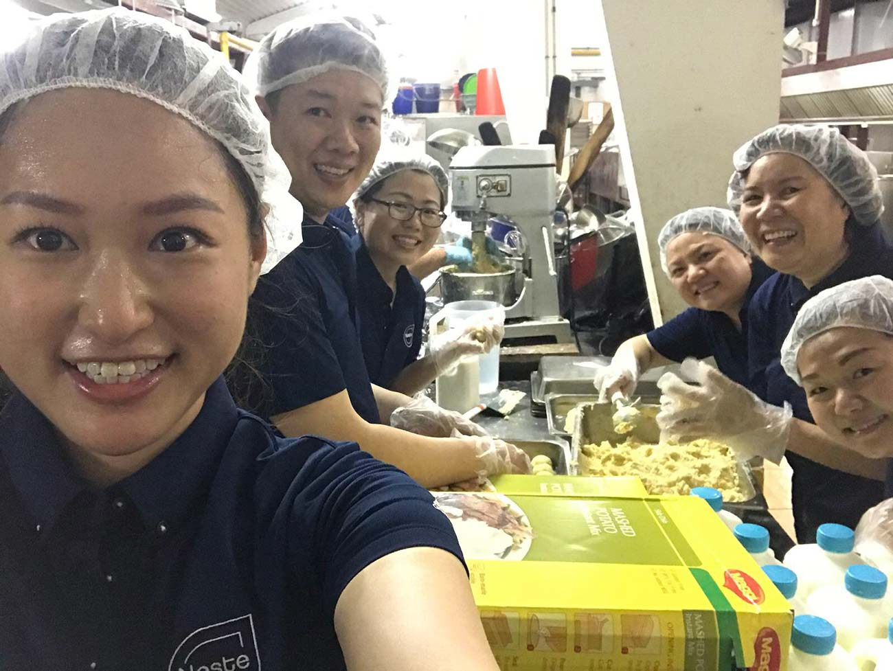 Singapore team did volunteering work preparing meals at Willing Hearts.