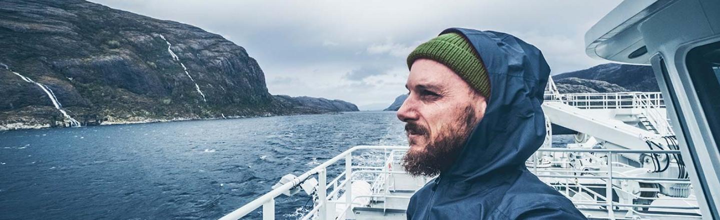 A man standing on a ship deck in Scandinavia