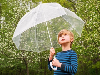 A boy with an umbrella made of plastics