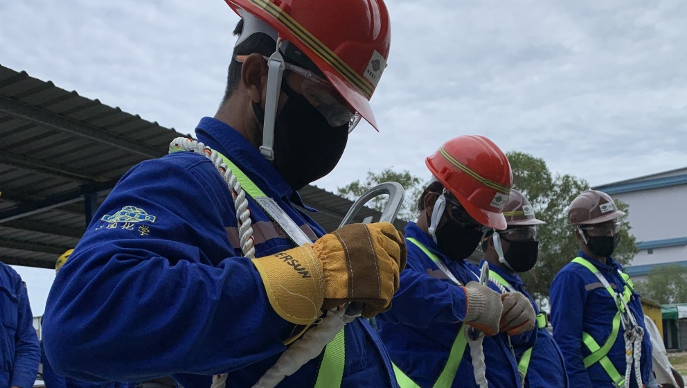 Migrant workers with Masks - Neste Singapore Expansion Project